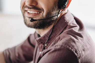 Cropped shot of smiling call center worker with microphone stock vector