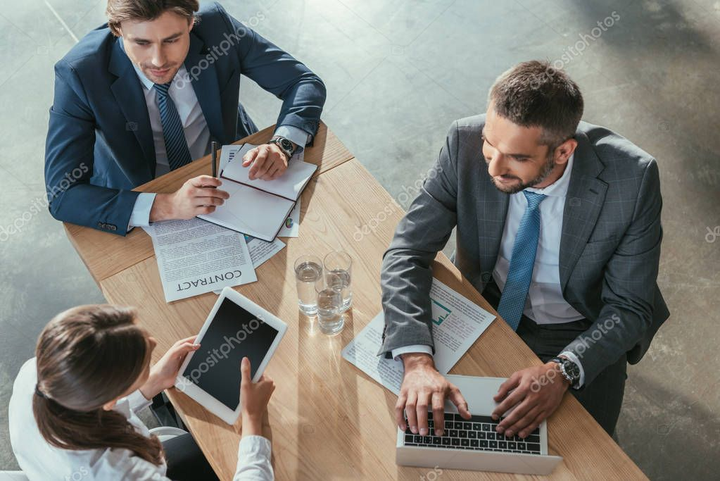 high angle view of happy business people working together at modern office