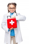 Photo smiling schoolchild in costume of doctor holding first aid kit isolated on white
