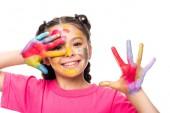 glückliches Schulkind zeigt bemalte Hände isoliert auf Weiß