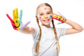 Fotografie happy schoolchild showing painted hands with smiley icons isolated on white