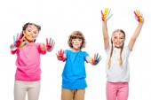 three classmates having fun and showing painted hands with smiley icons isolated on white