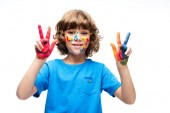 Fotografie schoolboy showing painted fingers isolated on white
