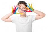 Fotografie adorable schoolboy showing painted hands with smiley icons isolated on white