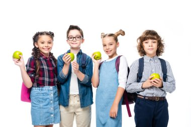 smiling schoolchildren holding ripe apples isolated on white
