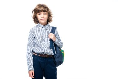 schoolboy holding backpack and looking at camera isolated on white