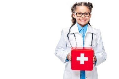 schoolchild in costume of doctor holding first aid kit isolated on white