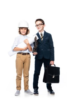schoolboys in costumes of architect and lawyer looking at camera isolated on white