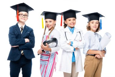 schoolchildren in costumes of different professions and graduation caps isolated on white