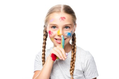 Schoolchild with paints on face showing silence gesture isolated on white stock vector