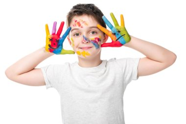 Adorable schoolboy showing painted hands with smiley icons isolated on white stock vector