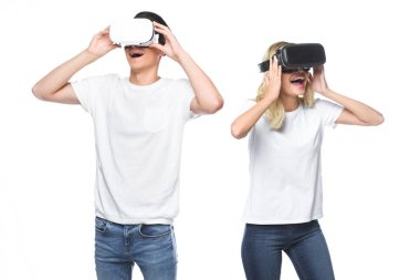 Excited couple using virtual reality headsets isolated on white stock vector