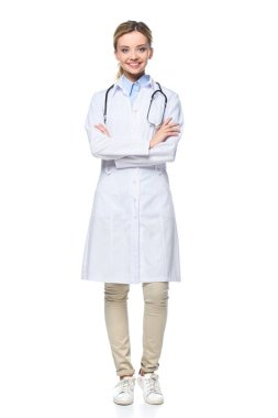 Young female doctor in white coat posing with crossed arms, isolated on white stock vector