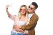 Fotografie happy young couple taking selfie with smartphone isolated on white