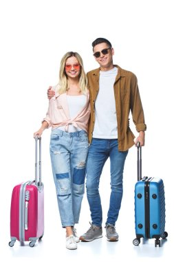 Happy travelling couple with suitcases looking at camera isolated on white stock vector