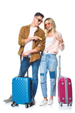 young travelling couple with suitcases and credit card isolated on white