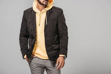 cropped image of male model in stylish autumn outfit isolated on grey background