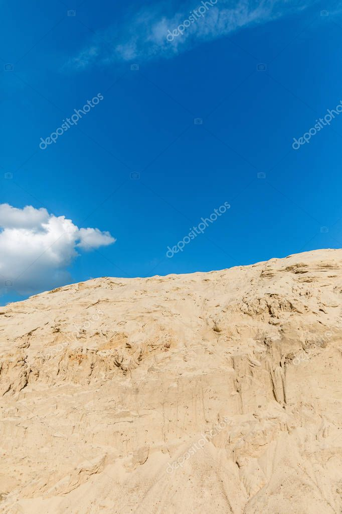 empty landscape with sand dune in desert, blue sky and clouds