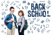 Photo two schoolboys with backpacks looking at camera isolated on white, with icons and back to school lettering