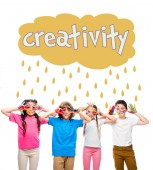 Fotografie schoolchildren having fun and showing painted hands with smiley icons isolated on white, with creativity lettering in cloud with rain drops