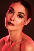 Fotografie portrait of beautiful model with makeup posing for fashion shoot, red toned picture