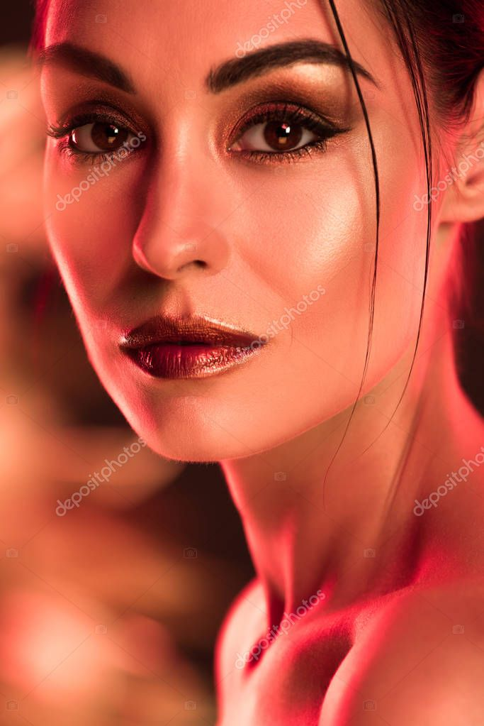 Portrait of elegant girl with makeup, red toned picture stock vector