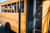 partial view of opened empty school bus parked on street