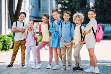 group of adorable pupils posing in school garden