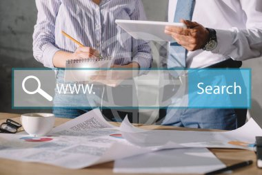 Seo managers working with documents and digital tablet, with website search bar stock vector