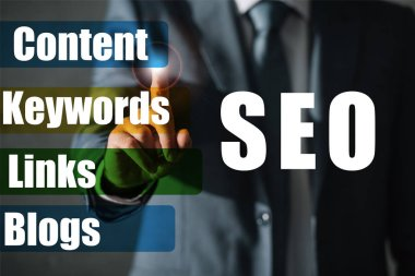 cropped view of professional seo manager in suit touching SEO ideas