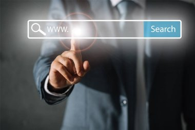cropped view of seo manager in suit touching website search bar