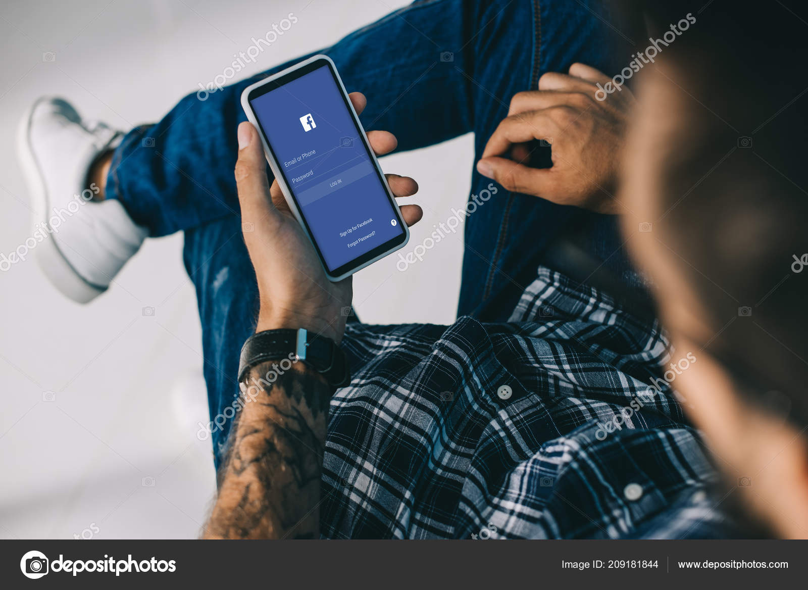 Partial View Man Using Smartphone Facebook App – Stock