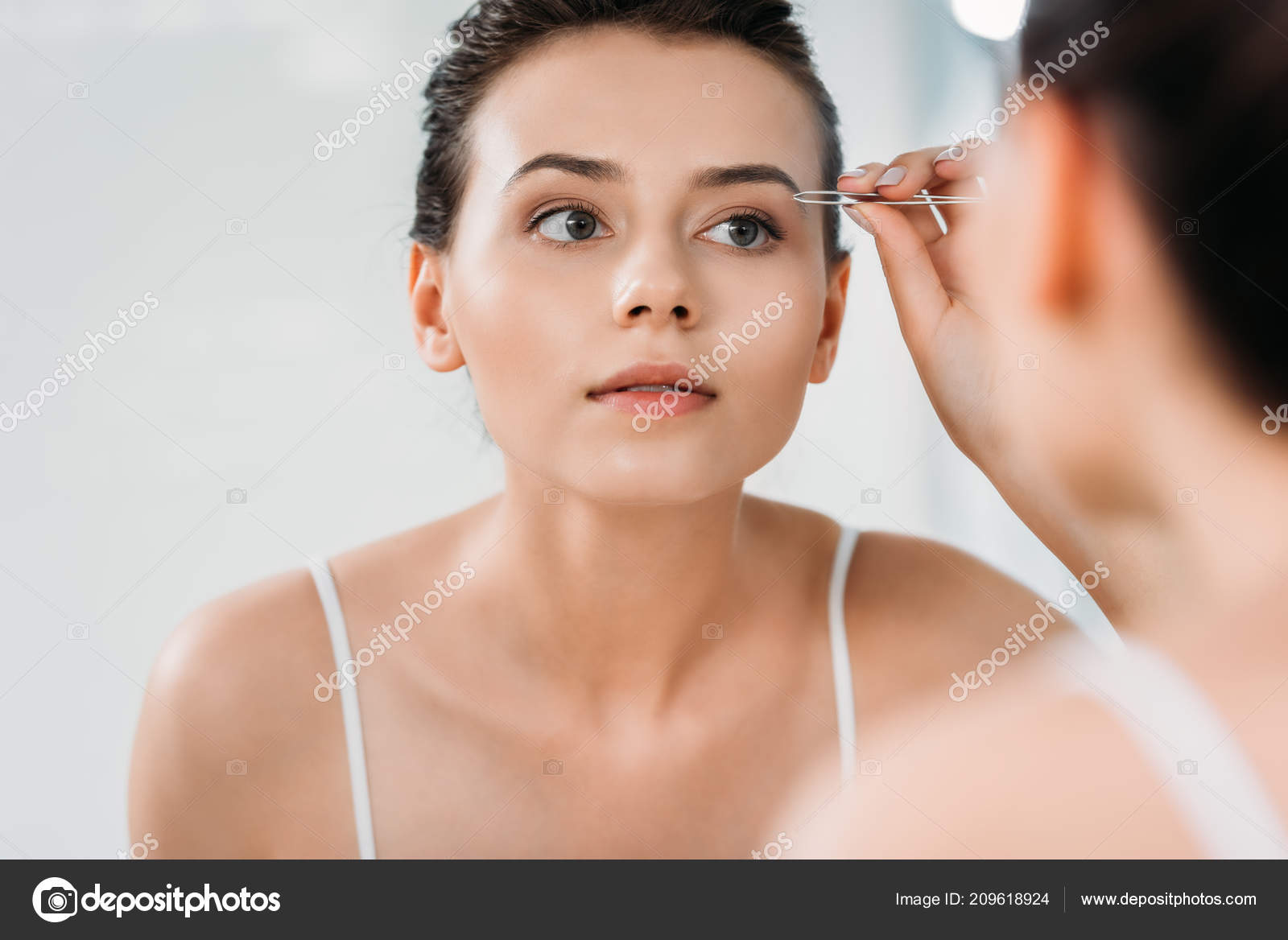 Selective Focus Girl Correcting Eyebrows Tweezers Looking Mirror