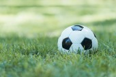 close-up view of leather soccer ball on green grass