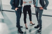 Photo cropped shot of group of male and female business people at modern office