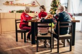 selective focus of big family with little kids sitting at table during christmas dinner at home