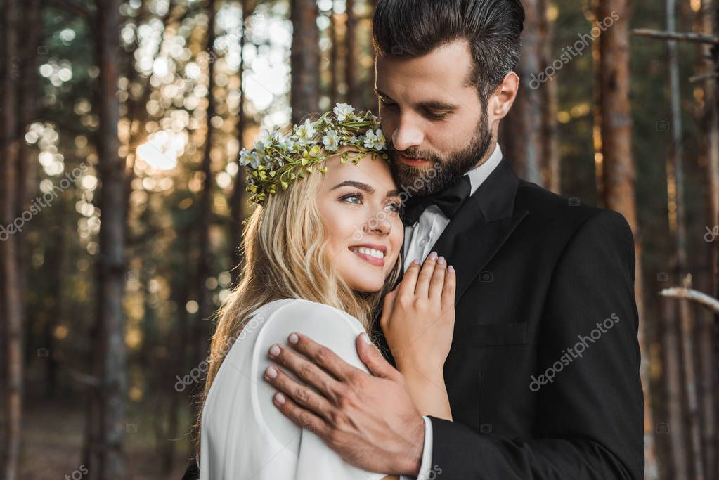 Beautiful wedding couple hugging in forest stock vector