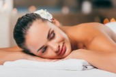 Photo happy woman sleeping at spa salon