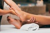 Fotografie cropped view of woman having feet massage in spa salon