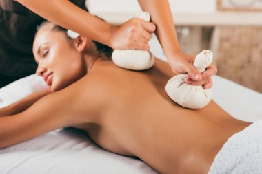 attractive woman receiving treatment at massage center