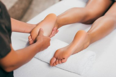 cropped view of woman having feet massage in spa salon