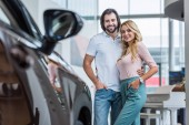 Fotografie portrait of happy couple hugging at dealership salon