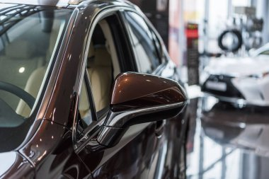 selective focus of luxury cars at dealership salon