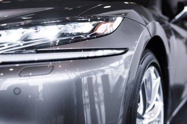 close up view of luxury shiny car in auto salon