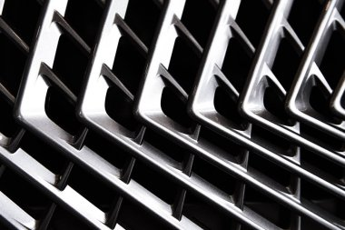 full frame of car metal grating as background