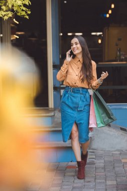 "Картина, постер, плакат, фотообои ""young stylish woman with shopping bags talking on smartphone at city street"", артикул 214815562"