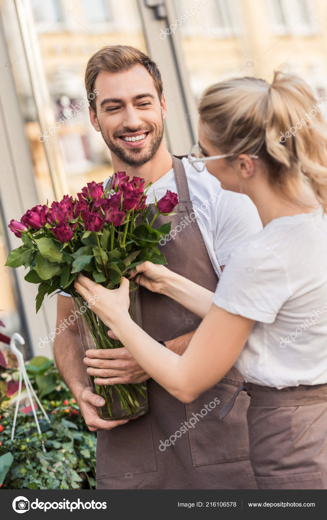 Happy Young Florists Holding Burgundy Roses Flower Shop