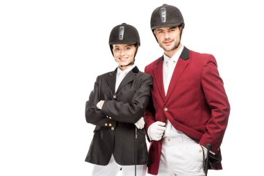successful young equestrians in uniform and helmets looking at camera isolated on white
