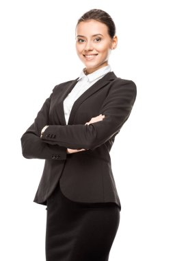 Happy young businesswoman in suit looking at camera with crossed arms isolated on white stock vector
