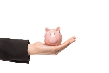 cropped shot of businesswoman holding piggy bank isolated on white